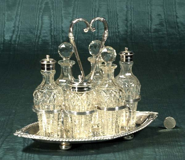 10: Fine silver plated caster set with six cut crystal