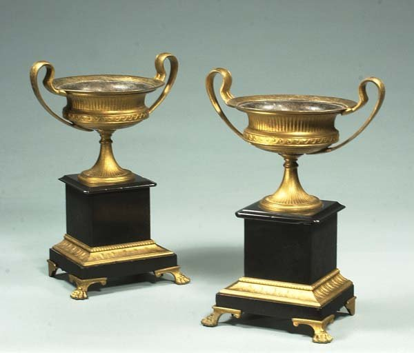 16: Pair of neoclassical bronze and marble urns on claw
