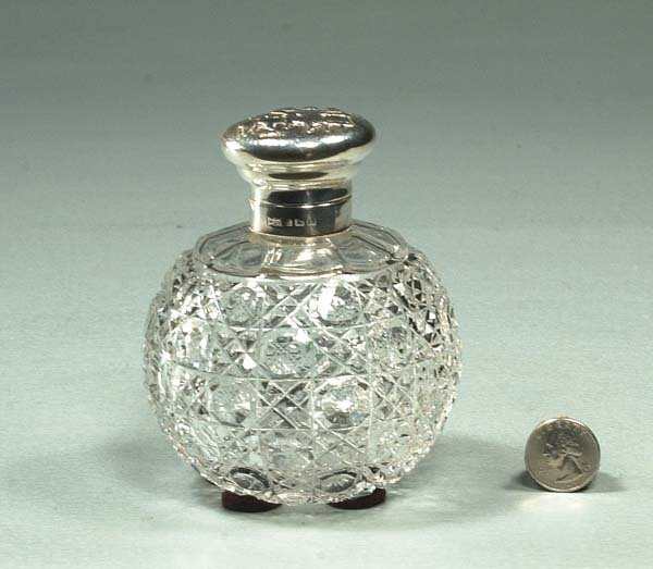 22: English cut crystal cologne bottle with silver moun