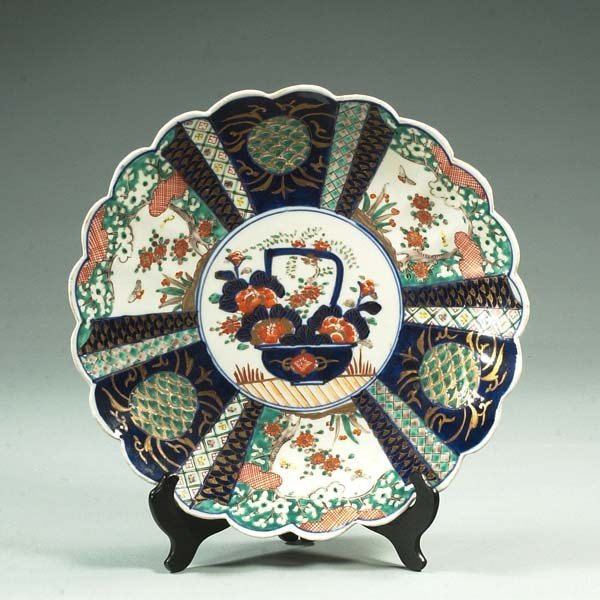 23: Imari porcelain charger with butterfly and floral d