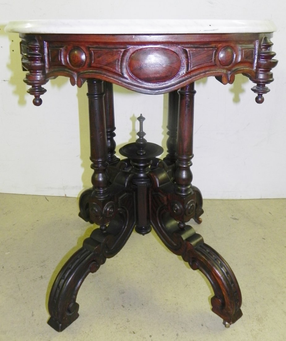 CARVED PARLOR TABLE - 4