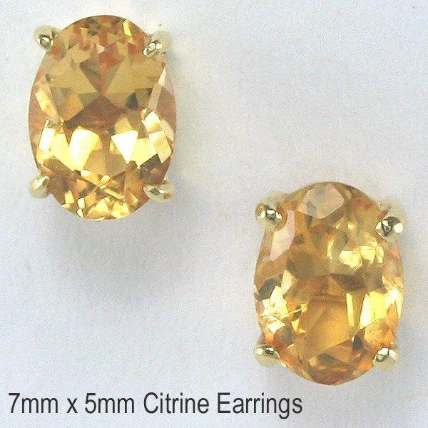 1027: 14KT 1.48tcw Citrine Stud Earrings 7mm
