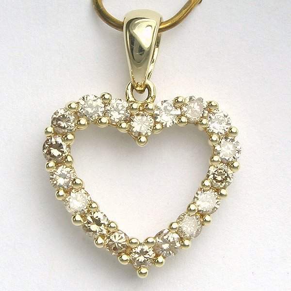 1018: 14KT Half Carat Diamond Heart Pendant 18mm