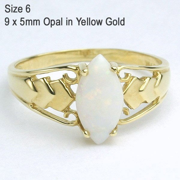 1245: 14KT Marquise Opal Ring Sz 6