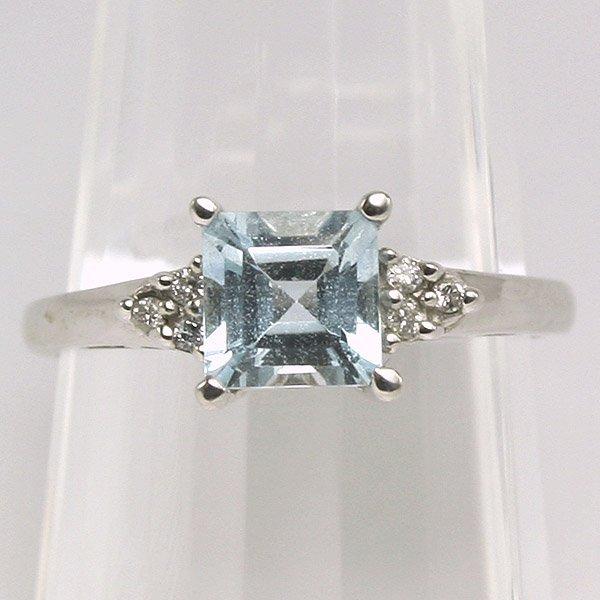 1491: 10K Aquamarine and Diamond Ring 0.06CT