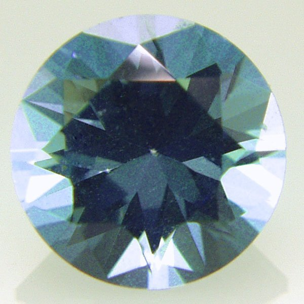 32006: Evergreen Topaz 7mm Round cut aprx 1.50cts