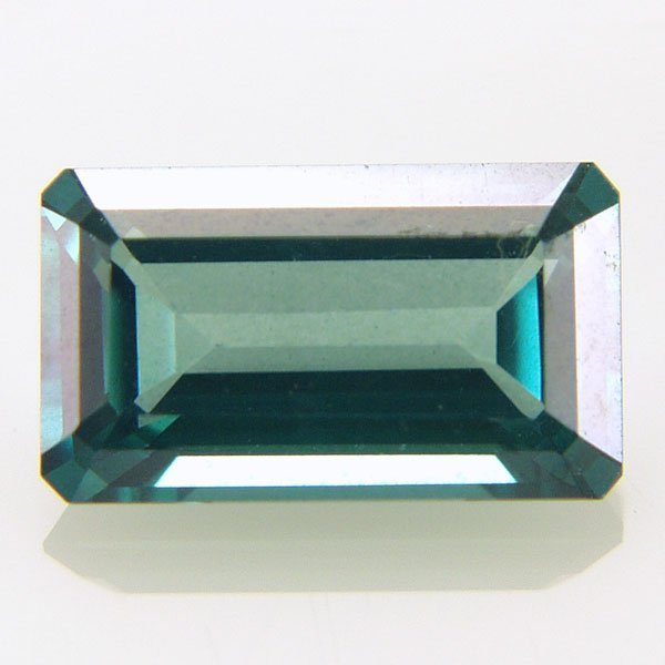 32014: Evergreen Topaz 12x7mm Emerald Cut aprx 6.12cts