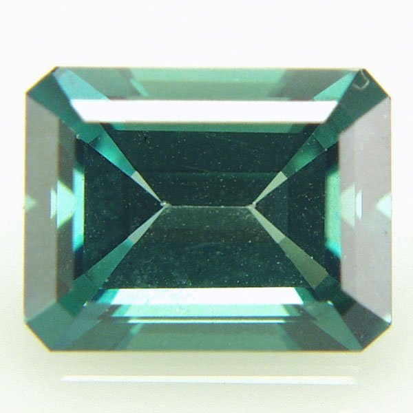 32018: Evergreen Topaz 9x7mm Emerald Cut aprx 2.28cts