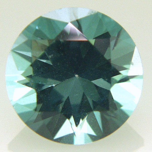 41025: Evergreen Topaz 8mm Round Cut aprx 2.30cts