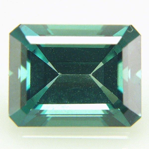 42011: Evergreen Topaz 9x7mm Emerald Cut aprx 2.46cts