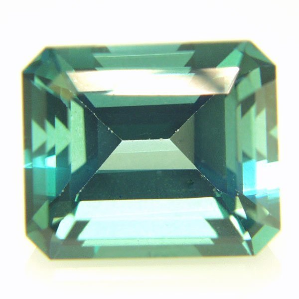 32012: Evergreen Topaz 12x10mm Emerald Cut aprx 7.12cts