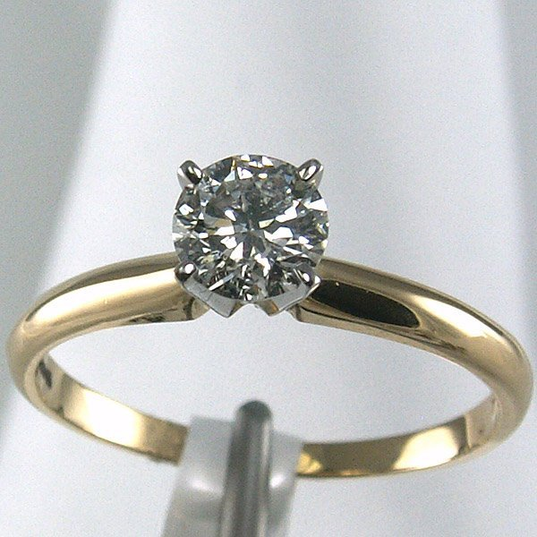 11029: 14KT. Diamond Solitaire Ring 0.47 CTS.
