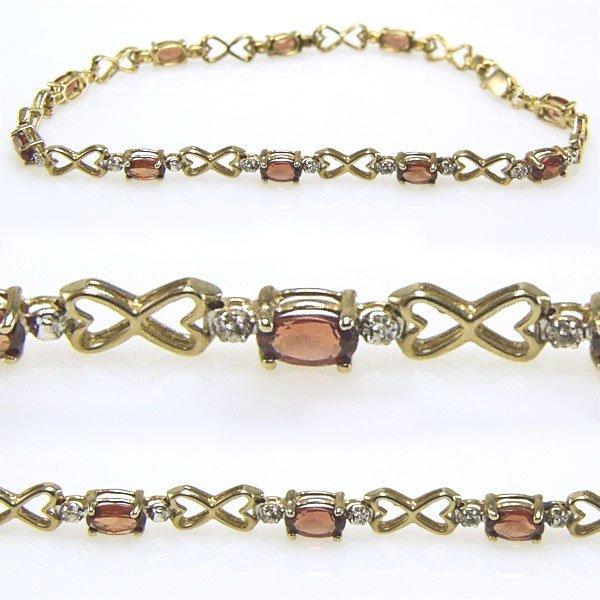 11635: 10KT Garnet & Dia Heart Bracelet 7in 2.21tcw