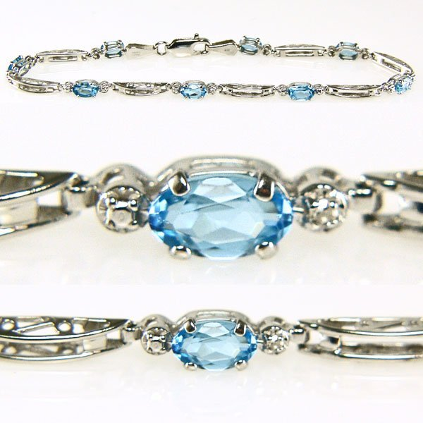22028: 10KT Blue Topaz & Dia Bracelet 7in 1.684tcw