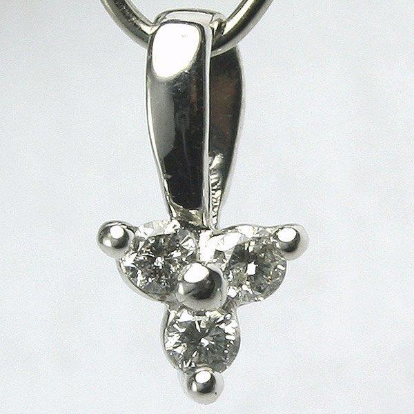 21039: 10KT Three Diamond Flower Pendant 0.12tcw
