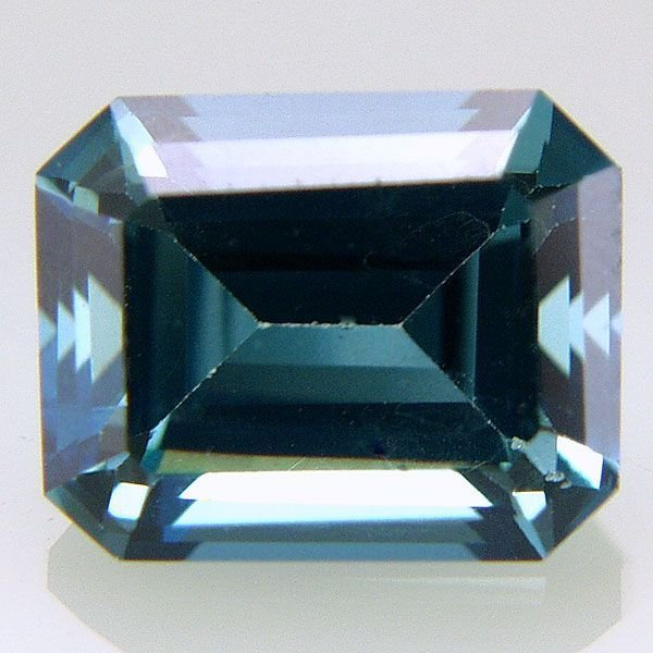 31019: Evergreen Topaz 10x8mm Emerald Cut 4.25cts