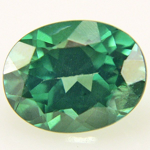 51018: EVERGREEN TOPAZ 8X6MM OVAL CUT  1.44CTS