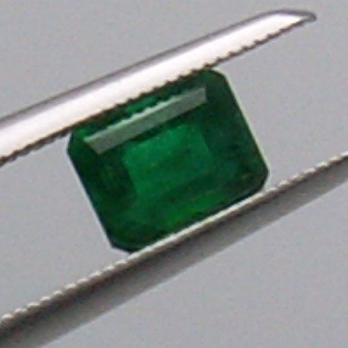 51060: 0.43CT EMERALD CUT EMERALD 4X5MM