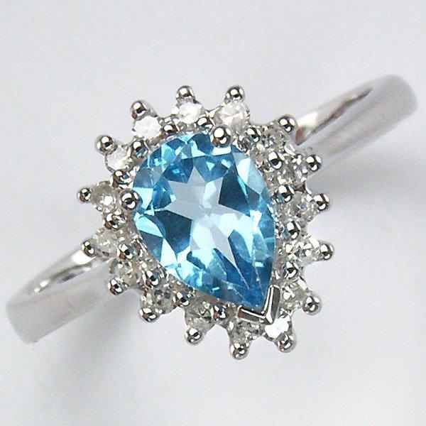 21008: 14KT DIAMOND BLUE TOPAZ RING 0.93TCW