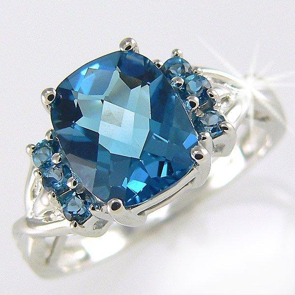 21436: 10KW BLUE TOPAZ -10X8MM RING SZ 7