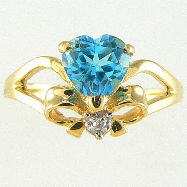 1006: 14KT BLUE TOPAZ DIAMOND RING 0.93TCW SZ 7