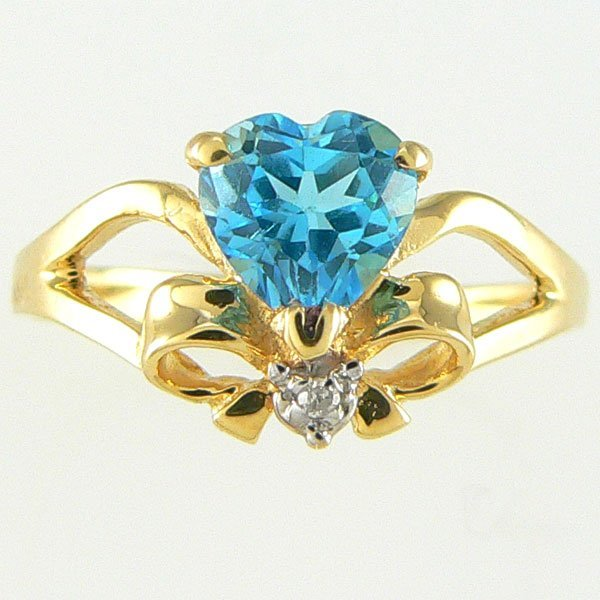 5006: 14KT BLUE TOPAZ DIAMOND RING 0.93TCW SZ 7
