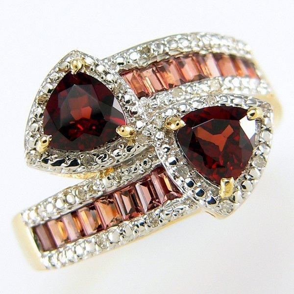 500008: 14KY GARNET DIAMOND BYPASS RING SZ 9