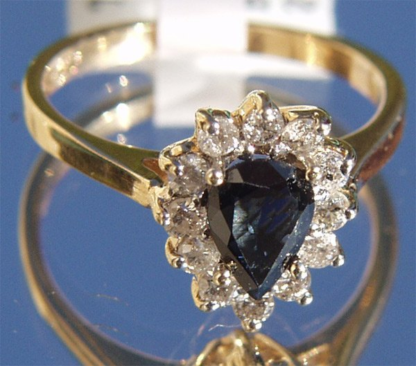 5038: 14Kt Sapphire Diamond Ring