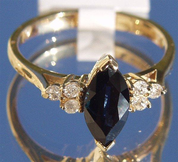 5039: 14Kt Sapphire Diamond Ring