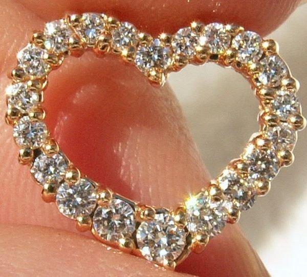 1003: 14KT. Diamond Open Heart Slider 0.50 CTS.