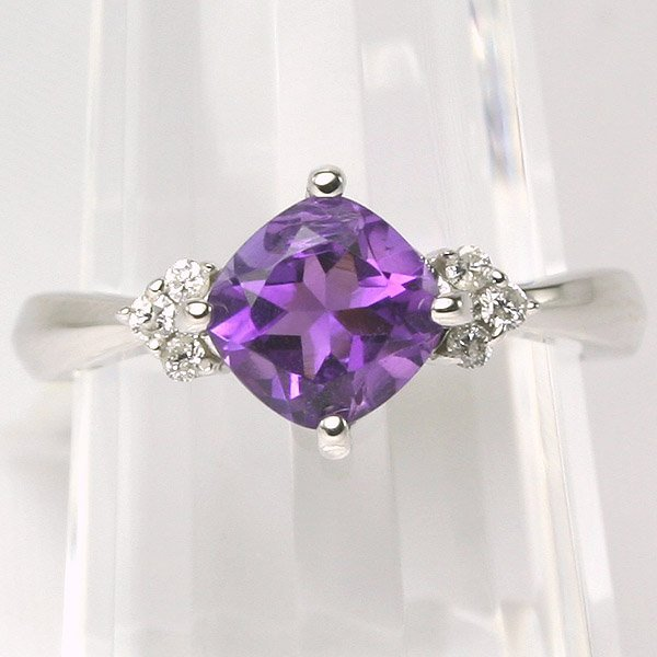1403: 10KT Amethyst and Diamond Ring 0.09CT