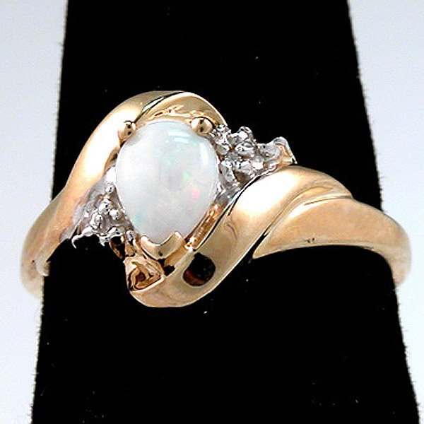 4008: 10KT Opal Diamond Ring Sz 6.75
