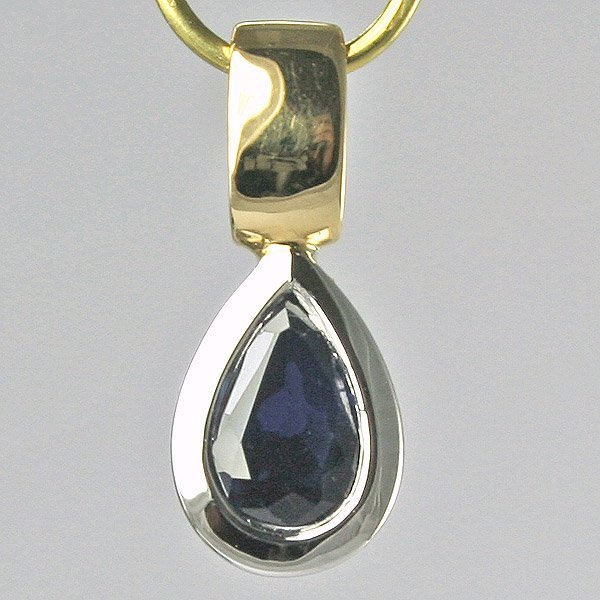 1023: 18KT Pear shaped Sapp. 0.50CTS Two Toned 0.93gm P