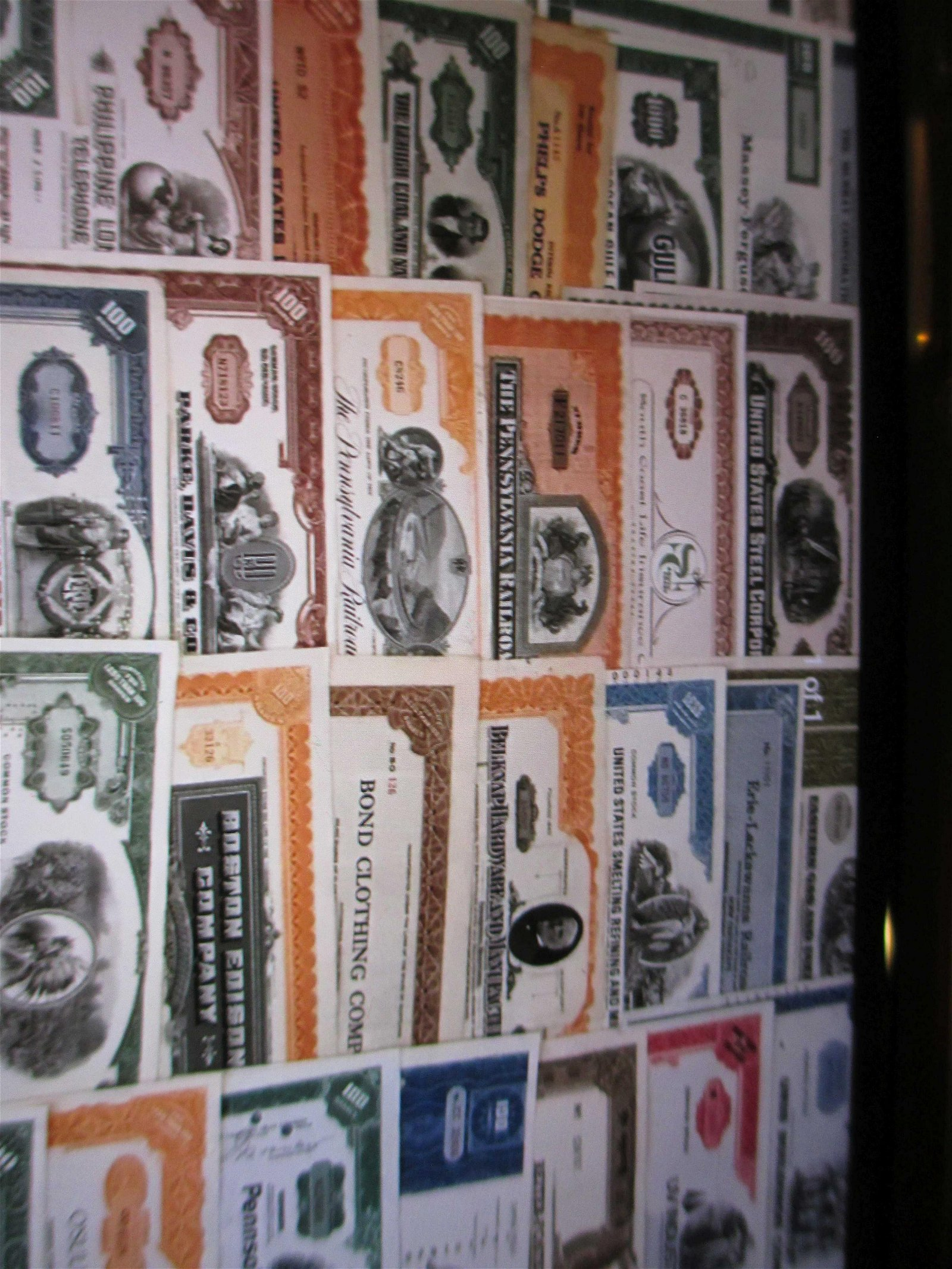 lot of 100 different stock certificates
