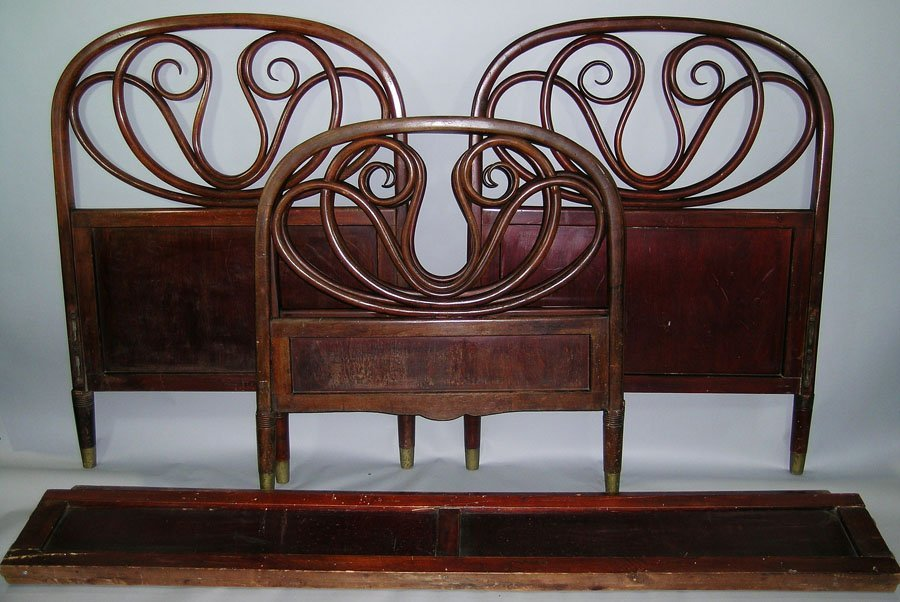 A Pair of Thonet Bentwood Single Beds, raised on