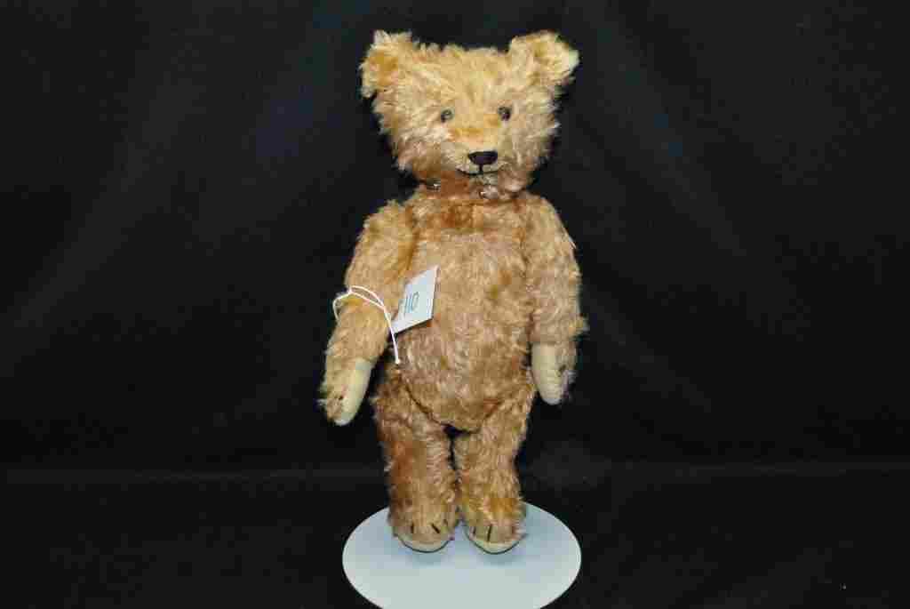 Antique teddy bear has bell ringer inside