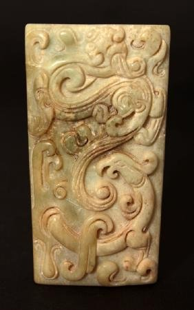 A CHINESE JADE PENDANT OF ARCHAIC FORM, carved in