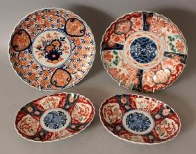 A PAIR OF 19TH/20TH CENTURY JAPANESE IMARI FLUTED OVAL