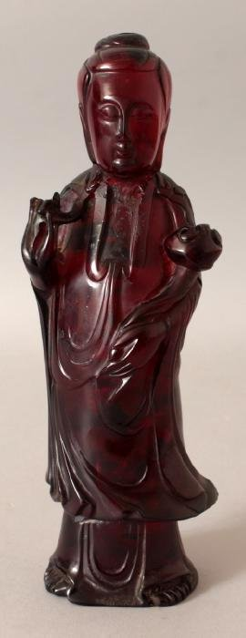 A CHINESE AMBER-LIKE FIGURE OF GUANYIN, standing and