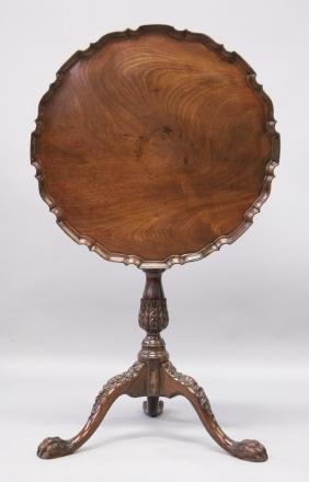 A CHIPPENDALE STYLE MAHOGANY TILT TOP TRIPOD TABLE,