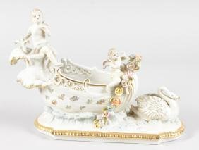 A DRESDEN STYLE PORCELAIN BOAT with swan and cupids.