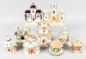 A SMALL COLLECTION OF NINE STAFFORDSHIRE COTTAGES AND