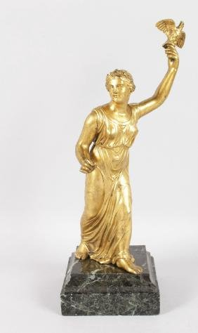 A CLASSICAL GILT BRONZE FIGURE, holding an eagle on a