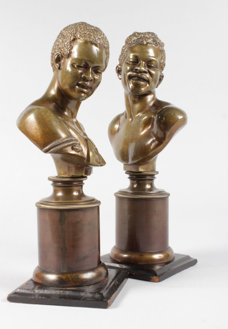 A RARE PAIR OF 19TH CENTURY BRONZES OF NEGRO BUSTS