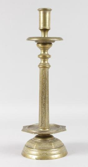 AN EARLY CONTINENTAL ETCHED CANDLESTICK with drip pan,