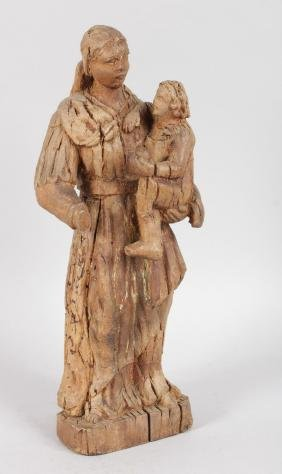 A 17TH CENTURY ITALIAN CARVED WOOD MADONNA AND CHILD.