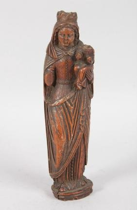 A SMALL 17TH CENTURY CARVED WALNUT MADONNA AND CHILD.