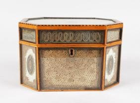 A GOOD GEORGE III ROLLED PAPER TEA CADDY, in a