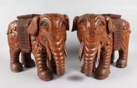 A PAIR OF CHINESE CARVED WOOD ELEPHANT STANDS.  12ins