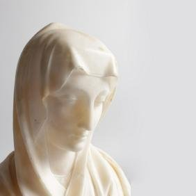 """AN ALABASTER BUST OF A YOUNG GIRL """"MADONNA"""".  11ins"""